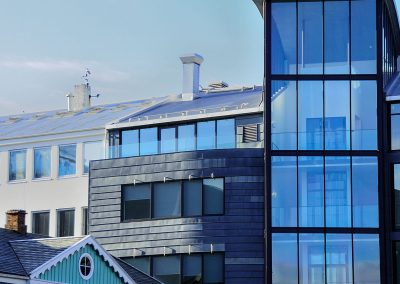 Blue wooden house and blue glass building
