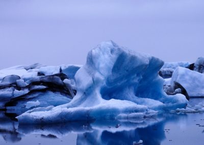 Iceberg at night with blue-purple colors