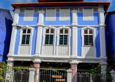3-storey light blue house