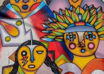 Colorful painting on a wall in the street showing 4 characters