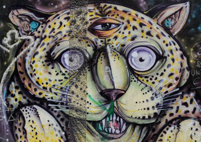 Painting on a wall of a leopard with a third eye on its forehead