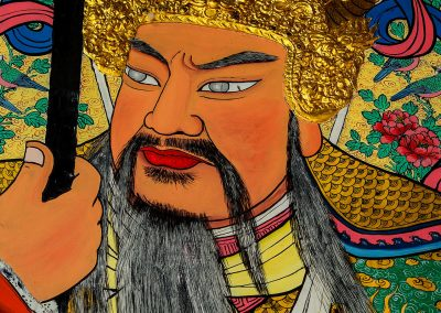 Portrait of a painting in a temple of a soldier with long beard and vivid colors