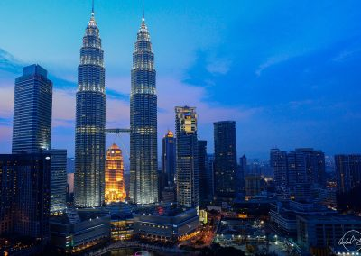 Petronas twin towers at sunset with dark blue sky