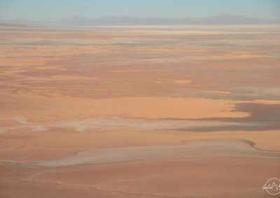View from the air of bolivian red desert with rivers