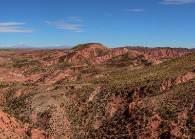 Panoramic view of landscape of red hills