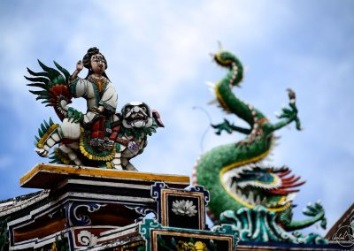 Statues of dragons on top of a roof