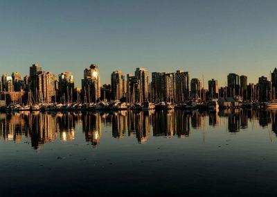 Skyline of buildings mirrored in the water