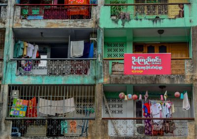 Building in Yangon with 5 floors with clothes hanging on each balcony