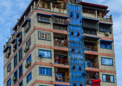 Building in Yangon with blue windows reflecting blue sky