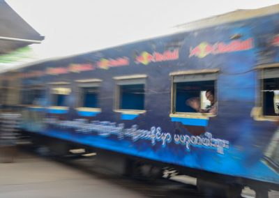 Blue train speeds u and leaves Yangon station