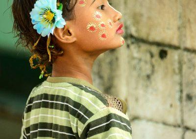 Little burmese girl with flower paintings on her cheeks