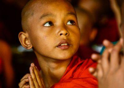 Child monk praying at lunch time in Bagan