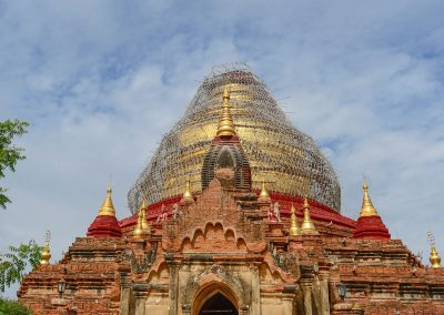 Golden and red dome of pagoda in Bagan