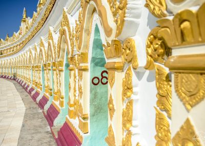 Outside of Umin Thonze pagoda white white, gold, green and red painting