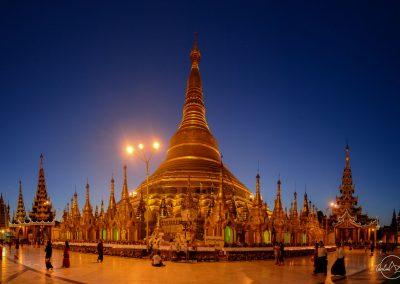 Shwedagon pagoda before sunrise with dark blue sky