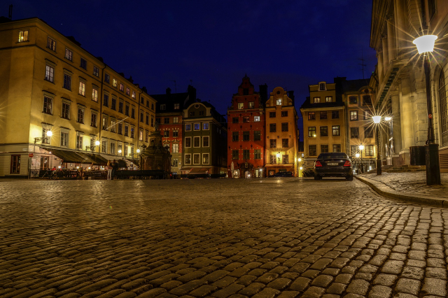 Pedestian street at night in Stockholm with lights forming a star effect