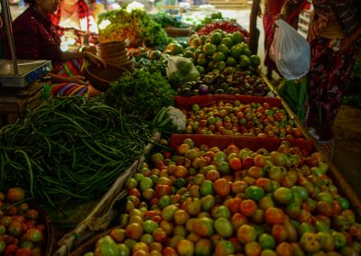 Stall full of tomatoes and green beans in an open market in Bagan