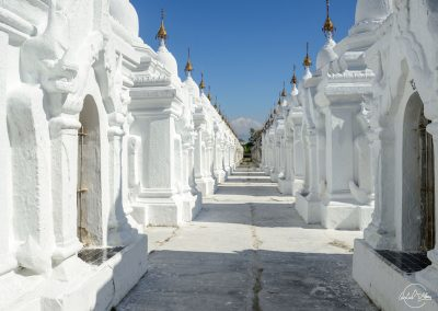 View of the white stupa houses at Kuthodaw pagoda
