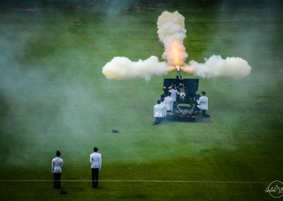 Fire of one cannon looking like a fireball surrouned by 3 columns of smoke during 21 guns salute from Padang yawn