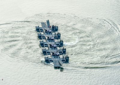 21 guns salute from a platform on the water, turning and creating spiral shape in the water