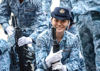 Portrait of Singapore female and young air force soldier smiling