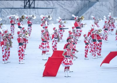 Band in red and white on Padang platform performing for the show