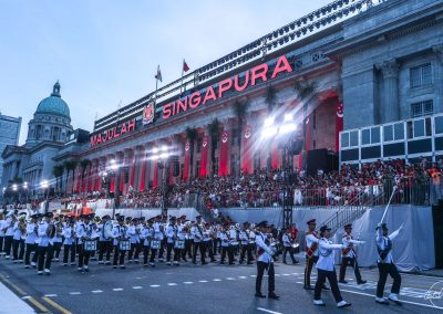 Contingent marching out from Padang with city hall in background