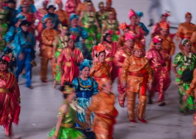 Dancers on stage at night with colorful dresses