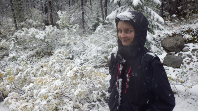 Hiker surrounded by snow