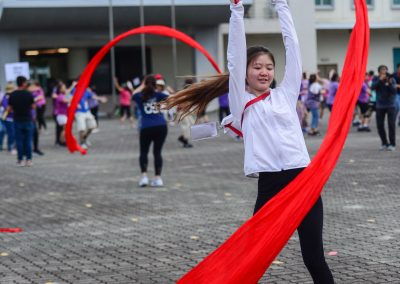 Young lady practising and with red ribbon