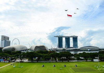 Singapore flagpast above Padang yawn and Marina Bay Sand