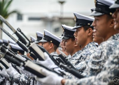 Portraits of Singapore navy soldiers in line and recharging their guns