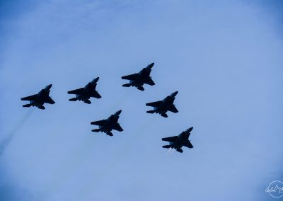 6 F15 flying in squadron in blue sky