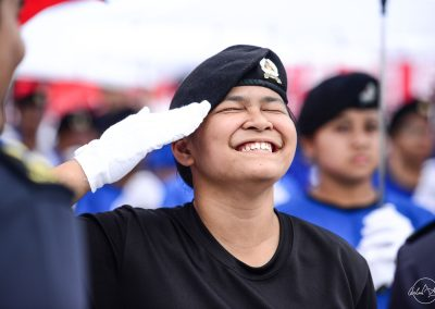 Young soldier laughing while ten-hut