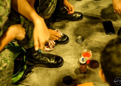 Shoes and hands of soliders sitting inside
