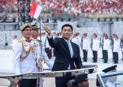 Speaker of parliament salute from car during national day rehearsal