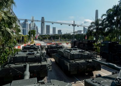 View from top of Singapore mobile columns with several tanks in foreground and financial center in background