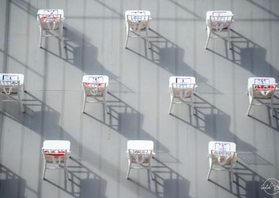 View from above of raws and columns of white chairs with welcome packs for Singapore national day at Padang