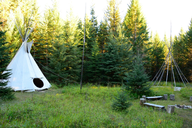 White tipi in the forest in Canada