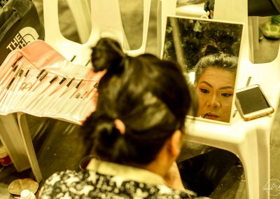 Woman putting make up before going on stage