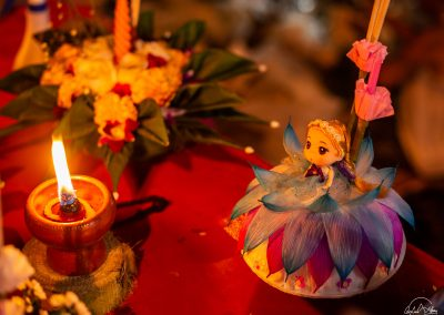 Little blond doll with a dress in purple and blue petals