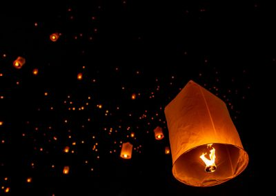 Several lanterns in the sky during Yi Peng festival