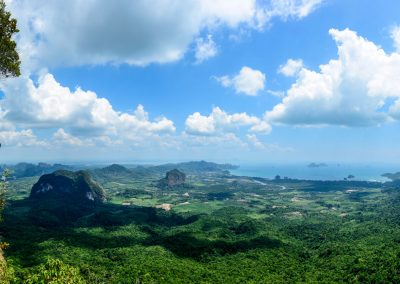 Panoramic picture from Tab Nak Hang Nak Viewpoint with stone in the shape of a tongue on the left and wide forest on the right