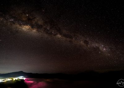 Milkyway above hills and city lights