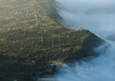 Villages on a cliff on the left with clouds evaporating on the right