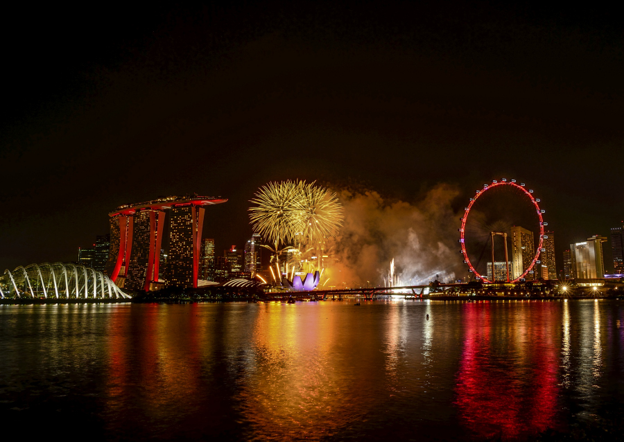 Fireworks in the middle with Singapore flyer on the right and MBS and the garden on the left